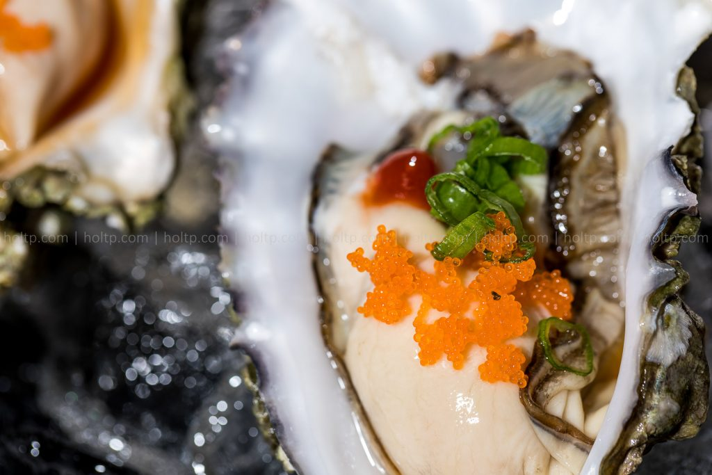Oyster with Masago on Ice Appetizer Closeup Photo